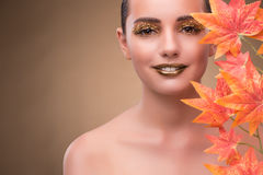 The young woman with dry autumn leaves. Young woman with dry autumn leaves stock photo