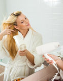 Young Woman drying hair Royalty Free Stock Photo