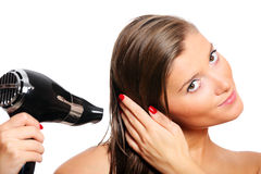 Young woman drying hair Stock Images