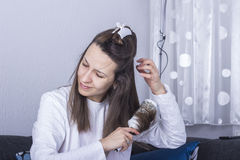 Young woman drying hair Royalty Free Stock Photos