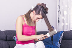 Young woman drying hair Royalty Free Stock Image