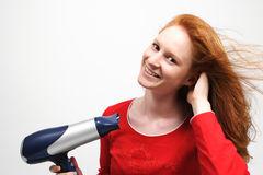 Young Woman Drying Her Hair Royalty Free Stock Photo