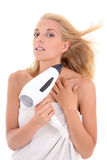 Young woman drying her hair with hairdryer Stock Images