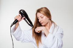 Young woman drying her hair Royalty Free Stock Image
