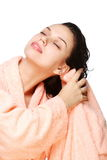 Young woman drys hairs with towel. Stock Photos