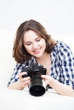 Young woman with a dslr camera Royalty Free Stock Photo