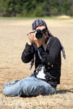 Young woman with DSLR camera outdoors Stock Photography