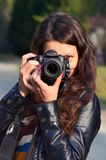 Young woman with DSLR camera Stock Photos
