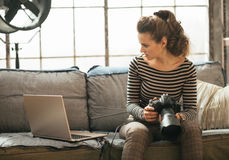 Young woman with dslr photo camera using laptop Royalty Free Stock Images