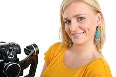 Young woman with dslr video stabilizer, on white Royalty Free Stock Photo