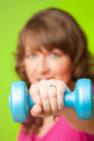 Young woman with dumbbell Royalty Free Stock Images