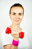 Young woman with dumbbell,  Stock Photography