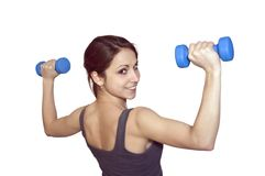 The young woman with dumbbells Stock Images