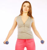 Young woman with dumbbells Stock Image