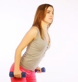 Young woman with dumbbells Stock Photography
