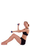 A young woman with dumbbells Stock Photography