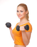 Young woman with dumbbells Royalty Free Stock Photo