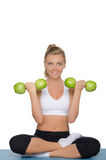 Young woman with dumbbells of green apples Stock Image