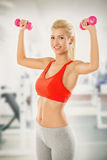 Young Woman With Dumbbells At The Gym Stock Photography
