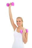 Young woman with dumbbells over white Stock Photo