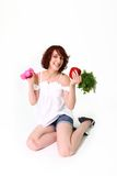 Young woman with dumbbells and vegetables Royalty Free Stock Images