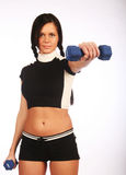 Young woman with dumbbells Royalty Free Stock Image