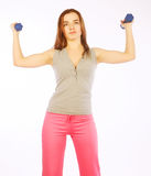 Young woman with dumbbells Royalty Free Stock Photography