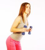 Young woman with dumbbells Royalty Free Stock Photos