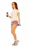 Young woman with dumbbells Royalty Free Stock Images