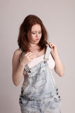 Young woman in dungarees Royalty Free Stock Photography