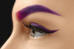 Young woman with dyed eyebrow, closeup royalty free stock photo