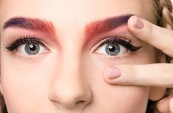 Young woman with dyed eyebrows,. Closeup Stock Photo