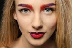 Young woman with dyed eyebrows,. Closeup royalty free stock image