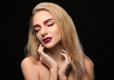 Young woman with dyed eyebrows. On black background royalty free stock photos