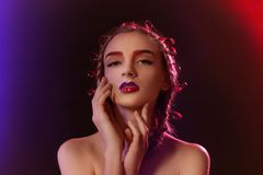 Young woman with dyed eyebrows. On dark background royalty free stock image
