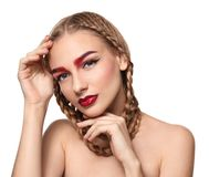 Young woman with dyed eyebrows. On white background stock images