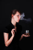 Young woman with e-cigarette and Whiskey Stock Image