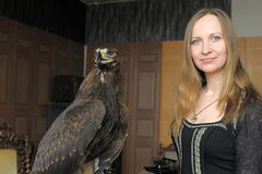 Young woman  with an eagle behind Royalty Free Stock Image