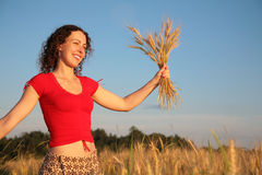 Young woman with earns on wheaten field royalty free stock image