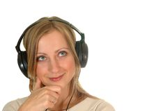 Young woman with earphones. Young woman wearing earphones and listening music Royalty Free Stock Photos