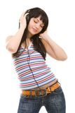 Young woman in earphones Stock Image