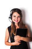 Young woman in earphones and microphone with tablet, isolated Stock Photos