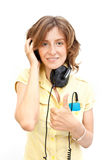 Young woman with earphones over white Royalty Free Stock Photography