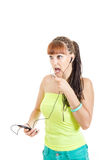 Young woman with earphones talking to a friend using mobile Royalty Free Stock Photos