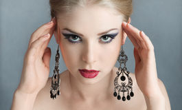 Young woman with earring Stock Photo