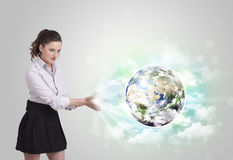 Young woman with earth and cloud concept Stock Images