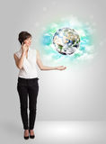 Young woman with earth and cloud concept Stock Image