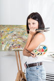 Young woman with an easel Stock Photos