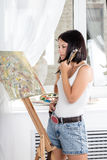 Young woman with an easel Stock Photo