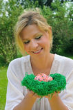 Young woman and easter eggs Stock Photography